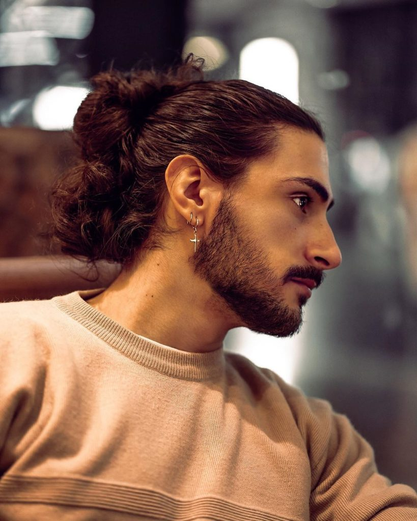 All you need to do is pull your long wavy hair into a messy, swirly bun and ready to go out. 21 Man Bun Styles Keep Your Long Hair Pulled Back Looking Stylish
