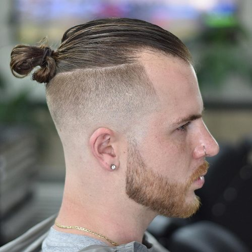 This hybrid hairstyle is a blend of the slicked back undercut and. 11 Awesome Man Bun Hairstyles With A Fade For 2021