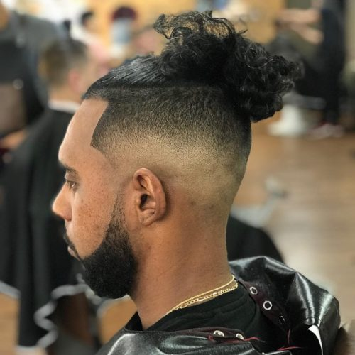 Twisted man bun/ puff hairstyle for black men black man bun | black man bun the vanishing half may assume ancient but it's cleverly complete to both bout and appraisal the conservativism of the 1950s and 60s: 11 Awesome Man Bun Hairstyles With A Fade For 2021